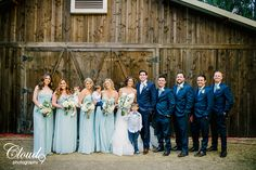 Rustic malibue wedding at calamigos ranch bride strapless tulle ballgown with a beaded bodice and sweetheart neckline with groom navy blue suit with white dress shirt and long ivory tie with matching pocket square and brown dress shoes with bridesmaids long light blue dresses and groomsmen navy blue suits with long ivory ties