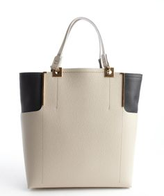 #LANVIN #Partition beige and black tote with gold accents.
