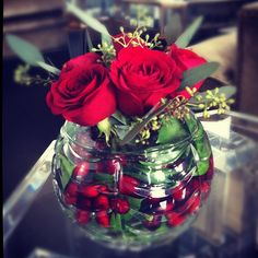 Red rose and cranberry glass floral arrangement