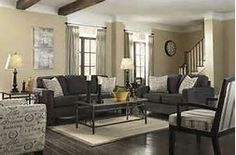 grey sofa dark floors beige walls