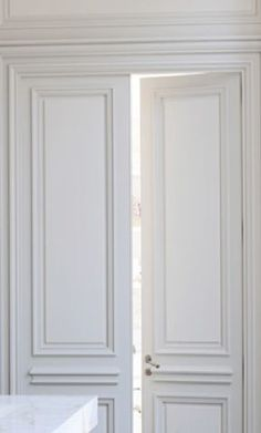 Double doors and picturing moulding walls for entrance hall High ceiling and double doors, Private Apartment in St Germain Des Prés, Paris by Joseph Dirand _ Parisian Apartment, Paris Apartments, Interior Barn Doors, Interior And Exterior, Interior Design, Exterior Doors, Double Doors Interior, Wainscoting Styles, Wainscoting Height