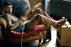 Zayn Malik poses with a Fender guitar, relaxing in a Prada sweater and jeans, paired with Giuseppe Zanotti Design boots and a David Yurman bracelet. Giuseppe Zanotti, Prada, Calvin Klein, Pose, Gq Style, Gq Magazine, John Hardy, Skinny, One Direction