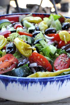 Greek salad!  Dressing changes- add a pinch of sugar, splash apple cider vinegar, 3/4 lemon...wait to put the dressing on until shortly before serving ( not overnight).
