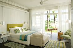 Long Beach, Mauritius. Keith Interior Design. Love the dark floors, sheers, and crown molding.
