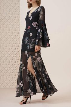 The Cosmic Girl Maxi Dress is simply stunning. It is soft and lightweight with a partial lining. It is beautifully fitted through the body and loosely flared down through the skirt, the deep V-neck line at front and back are definitely a stand out feature of the dress. Leading down to the extra full flared sleeves with double layers and front and back slits in the skirt that give a very dreamy look. It looks amazing paired with a pair of tan heels for any special event.    Cosmic Girl Maxi…