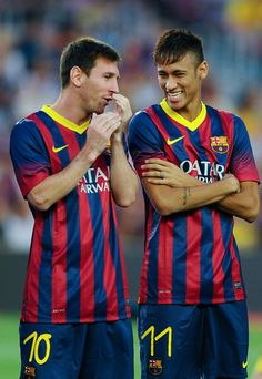 Lionel Messi (L) and his team-mate Neymar of FC Barcelona joke during the FC Barcelona offcial presentation prior to a friendly match between FC Barcelona and Santos at Nou Camp on August 2, 2013 in Barcelona, Spain.