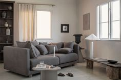 This moody wabi sabi livingroom in a sparse earthy palette creates a sophisticated backdrop for the statement making IKEA Stockholm 2017 sofa. The boxy lines are softened by the scattering of cushions and luxe Cocoa Brera Lino linen Bemz cover. Strike a balance between classic and contemporary forms and crisp monochromes to get the look.