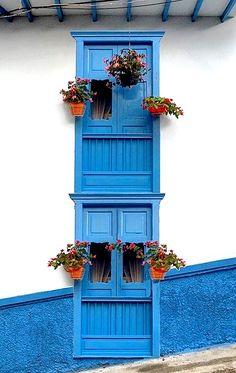 facade of residential building with colorful wooden windows Cool Doors, Unique Doors, Door Alarms, Door Gate, Window Boxes, Windows And Doors, Wooden Windows, Architectural Elements, Doorway