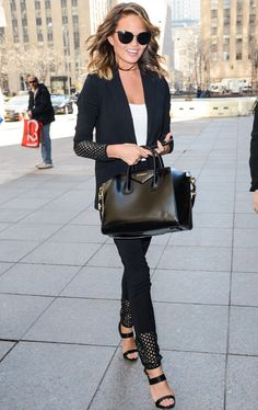 Latice Work from Celebrity Street Style  Whew! Chrissy Teigen nails it in a powerful black pantsuit with lattice work detail and an enviable Givenchy bag.
