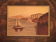 Such a lovely little marquetry piece of wall art! It features a sailboat…