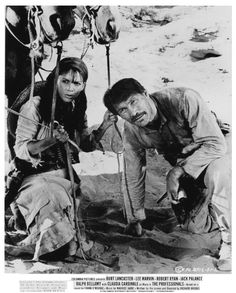 Marie Gomez and Jack Palance in the Professionals