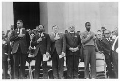 A young usher (far right), stands solemnly with religious, civil rights and labor leaders in front of the Lincoln Memorial during the National Anthem: (from left) Whitney Young Jr., Director of the National Urban League; Martin Luther King Jr., President of the Southern Christian Leadership Conference; Walter Reuther, President of the UAW;  Eugene Carson Blake, Chief Executive Officer of the United Presbyterian Church and Rabbi Joachim Prinz, President of the American Jewish Congress, 1963.