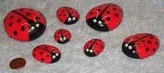 Ladybirds painted onto stones