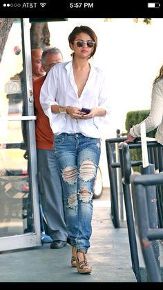 Salena Gomez in a low cut white t & adorable boyfriend jeans. Love her look!