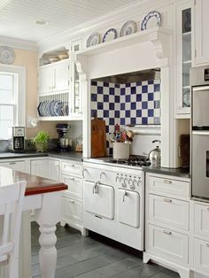 Tucked into a period-style alcove is a restored 1950s Chambers stove. | Cabinets @Plain & Fancy | Range backsplash: @artistictile | Range hood: @ventahood | Knobs and pulls: @hoah1