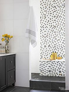 Direct attention to a doorless shower's entryway with a high-impact feature. This focal-point tile treatment grabs attention, sums up the bathroom's palette, and provides a color-apt transition to the white-tiled shower alcove to the left. A marble ledge keeps bathing necessities within reach and provides a spot for resting a foot when shaving legs.