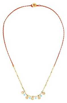 Free shipping and returns on SCOSHA Sunset Turquoise & Gold Trinket Necklace at Nordstrom.com. Designed in New York City, SCOSHA's jewelry is inspired by adventures and ancient weaving techniques from around the world. This gorgeous necklace features a fiery braided-nylon cord partially strung with gold-plated sterling-silver beads, accented with sterling-silver bezeled turquoise stones and golden sand-dollar charms.