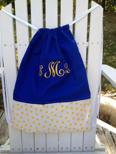 School spirit colors!  Great for a teen gift.    Personalized and Monogrammed Royal Blue and Yellow Polka Dot Cinch Sack - Drawstring Bag - Back Pack for girls. $26.00, via Etsy.