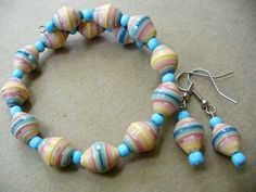classic colors PAPER BEAD memory wire bracelet and earrings set :)