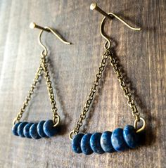 Polished Lapis lazuli beads, antique brass chain earrings. Length: ~1.5in Width…