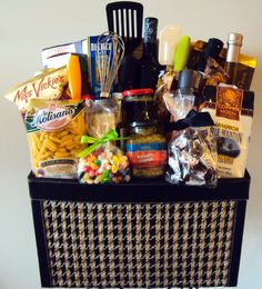 First time home buyers basket for the fellas! $200 custom gift basket This basket includes a bottle of fabulous Okanagan wine, a bamboo cutting board, Kitchan Aid cooking utencils, bar towels, 2 chef's knives, gourmet pasta and sauces, locally made hot sauce, sea salt, bruschetta, gourmet coffee, BC smoked salmon and all kinds of assorted snacks and treats! When only the best will do! Contact info@pinkshark.ca 250.808.8500 www.pinkshark.ca Coffee Gift Baskets, Housewarming Gift Baskets, Wedding Gift Baskets, Kids Gift Baskets, Gift Baskets For Women, Themed Gift Baskets, Gourmet Gift Baskets, Christmas Gift Baskets, Homemade Gift Baskets