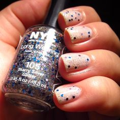 "One of the best  glitter nail polishes against a stark white nail.  Only $1.99, NYC nail polish brand #105 ""Starry Silver Glitter"" Originally from beauty blog nailnit.wordpress.com"