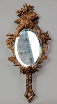 Black forest carved wood bear hand mirror.