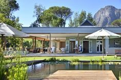 Angala Boutique Hotel & Guest House is 63 km away from Cape Town on the scenic slopes of the Simonsberg mountains in South Africa's Cape Winelands near Franschhoek. This exclusive country retreat, which lies in the heart of the Cape Winelands Clifton Beach, Pool Umbrellas, Golf Estate, Hotel Staff, Luxury Accommodation, Holiday Accommodation, Hotel Guest, South Africa, Beautiful Places