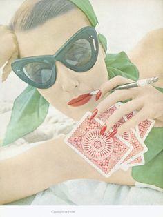Vintage photo by Richard Avedon of model in oversized atomic cat eye sunglasses, cigarette holder, and playing cards Richard Avedon, Irving Penn, Gordon Parks, Robert Mapplethorpe, Robert Doisneau, Photo Vintage, Look Vintage, Vintage Glamour, Vintage Romance