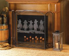 Five cowboys are about to finish their work for the day, riding fast and rounding up their livestock, which is artistically rendered on this rustic fireplace screen. The mesh center panel features this cowboy scene that will be beautifully backlit by the flickering flames in your fireplace. The screen's tri-fold construction allows you to fit this accent in your decor with ease.