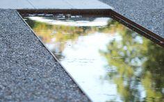 Wasserbecken in Kiesfläche Landschaftsarchitektur