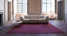 So - Modular seating system consisting of left, right, central elements, chaise longue and pouf.