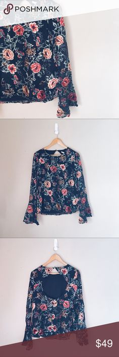 June and Hudson • Floral Bell Sleeve Open Back Top NWT Stunning blouse covered in roses and florals. Very feminine and flowy cut. Boho vibes, with romantic bell sleeves. Get this in time for Valentine's Day for a lovely date night statement piece. Pair this tucked into a pencil skirt or with a pair of boyfriend jeans and chunky heels. June and Hudson Tops Blouses