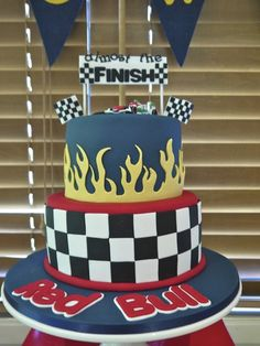 Checkerboard and flames cake at a Race car baby shower #racecar #babyshowercake