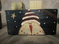 Snowman painted on a scrape piece of 4x4 wood.