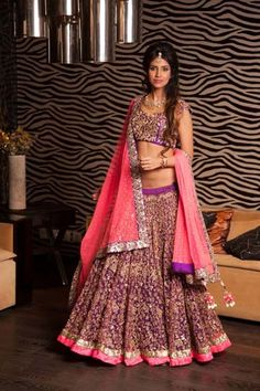 Purple and pink lehenga.  Indian wedding clothes.