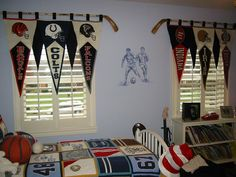 Wanted to share these pennant window treatment valences I made. I added tabs and small triangles to finish. I made the rod out of hockey sticks to fit the theme: Sports theme provided by Christina Lambert Custom Interiors & Upholstery