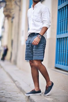men's resort wear outfit.  Button down shirt with striped shorts.