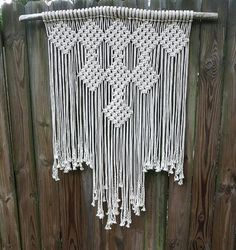 Large macrame wall hanging. Off white cotton rope on 44 inch branch. Macrame width is 33 inches wide and about 52 in length.