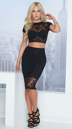 Dress to impress in this flirty black set featuring a sheer lace crop top with a high neckline, short sleeves, underwire cups, and a matching high waisted skirt with a sheer lace trim. Romantic Lacy Skirt Set, Black Lace Skirt Set, Sheer Lace Skirt Set