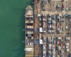 Port Poster featuring the photograph Container Ship Loading From Logistic Hub by Anek Suwannaphoom