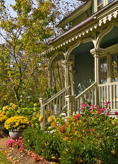This should go on my bucket list !wonderful Victorian front porch just waiting for a big swing