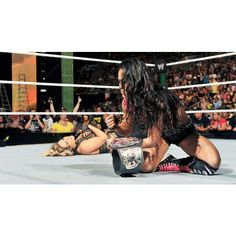 Kaitlyn vs. AJ Lee WWE Divas Championship Match photos ❤ liked on Polyvore featuring home, home decor, frames and wwe