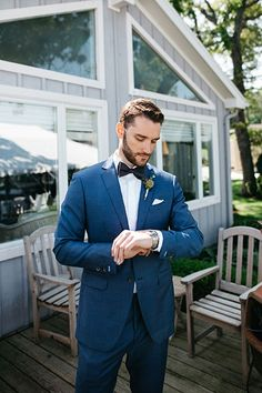 Blue is anything but basic when it comes to grooms and groomsmen attire. Midnight blue tuxedos with a black lapel or luminescent sheen are perfect for a formal soirée, and they look fantastic in photographs. (You can outfit the bridal party in gray to create contrast and have the groom stand out.) A more casual wedding might call for a navy suit with a skinny tie (or lack thereof).