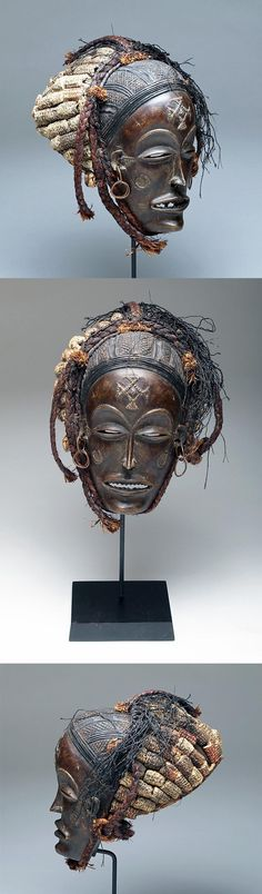 """Africa   """"Mwana Pwo' mask from the Chokwe people of Angola   Wood, carved corn row coiffure, plaited vegetal fiber, copper earrings   ca late 19th to early 20th century"""
