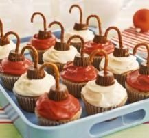 Ornament Cupcakes - Ice cupcakes with red or white frosting. Place a mini peanut butter cup candy upside down on top of the cupcake. Break off the rounded parts of pretzels so they resemble ornament hooks and insert them through the peanut butter cups down into the cupcakes - bjl