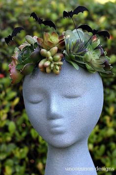 Make a faux Halloween Goddess Sculpture with a foam wig head.  Such a unique Halloween decoration! via Uncommon Designs