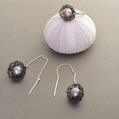 Freshwater pearls and sterling silver thread earrings with ring. Together they make a wonderful set.