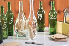 jor.dan photography - wine bottles for future anniversaries filled with advice from our guests :)