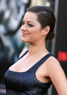 Marion Cotillard Classic Bun - Marion completed her flawless look with a classic, twisted bun.